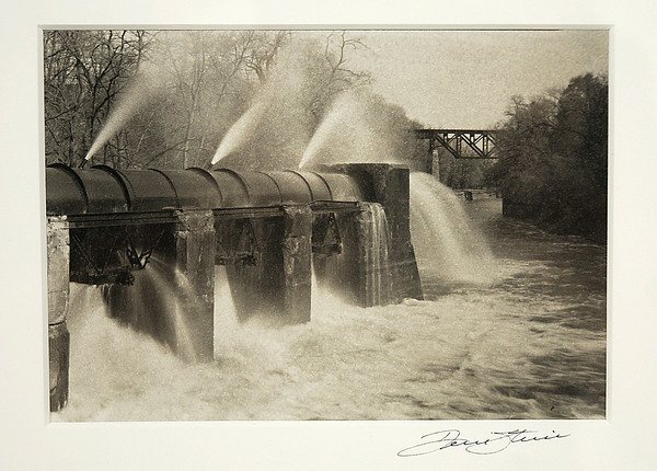 "James Neiss/staff photographerNiagara Falls, NY - Lockport Photographer Dennis Stierer shows off an award winning image titled ""Filling the Barge Canal,"" created using the hand coated platinum/palladium contact print process, in the Buffalo Society of Artists 116th Annual Catalog Exhibition that runs through November 3, at the Niagara Arts & Cultural Center."