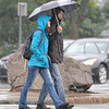 James Neiss/staff photographerNiagara Falls, NY - A little rain on Tuesday couldn't dampen the spirits of honeymooners Jurij and Maja Kalinsik as they cross Niagara Street. The newlywed couple are visiting all the way from Slovenia.
