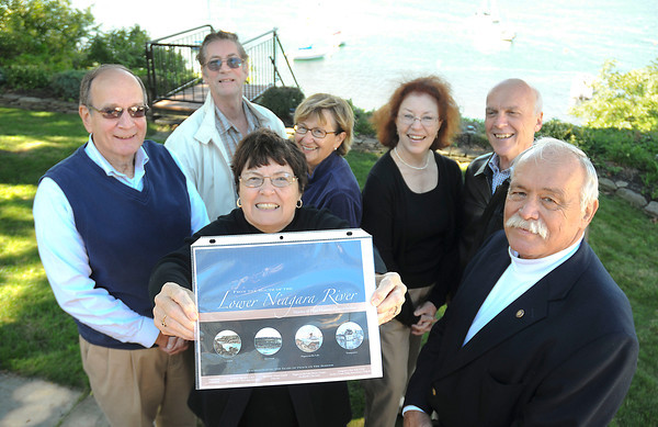 "James Neiss/staff photographerYoungstown, NY - Group collaborate to produce a new book, ""From the Mouth of the Lower Niagara River: Stories of Four Historic Communities."" From left are, Dennis Duling, Jim Smith, Gretchen Duling, Karen Noonan, Linda Fritz, Jim Reynolds and Clyde Burmaster."