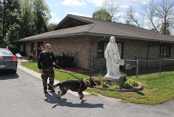 James Neiss/staff photographerNiagara Falls,  NY - Niagara County Sheriff Deputy Sean Furey and his K9 Vedder, were called to the Mount St. Mary's medical complex to help look for a parole violator that left the hospital. The Saint Mary's Child Care Center, behind, was in lockdown during the search.