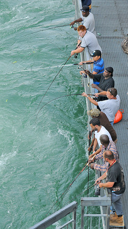 James Neiss/staff photographerNiagara Falls, NY - Fisherman line up on the New York Power Authority fishing platform in hopes of catching a King Salmon during their annual migration into the Niagara River.