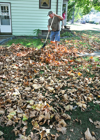 "James Neiss/staff photographerNiagara Falls, NY - It seemed like mid October not September 1st as Mike Roulley rakes the piles of leafs on his 74th Street lawn. ""I've had this problem since I moved here with these sycamore trees shedding all summer. I have to rake them up so I can cut the grass,"" said Roulley."