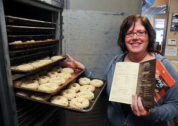 James Neiss/staff photographerNiagara Falls, NY - ON THE RISE: Niagara Falls Panera Bread General Manager Patty Shanley has the famous Cinnamon Crunch Bagel dough ready for opening day on Wednesday morning at 6 a.m. The first 120 in the restaurant will get a free travel mug, said Shanley.