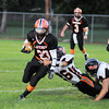 James Neiss/staff photographerWilson,  NY - Wilson Lakeman #23 John Piper runs with the ball during the second quarter of football game action against Fredonia.