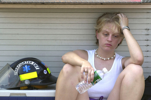 030814 power outage/cappy/dan cappellazzo photo/story/Nf- Katie Wruck, vol firefighter with Frontier Fire co. takes a break from working the roads during the height of the outage at the corner of River rd and Williams.