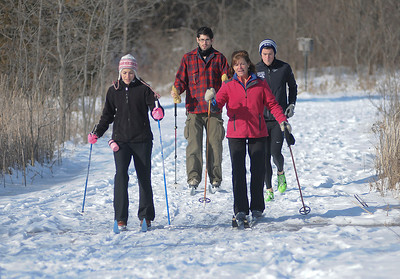 "James Neiss/staff photographerSanborn, NY - Kelsey, Joe and Patty Mash enjoyed Saturday morning cross country skiing, as family friend Chris Carter jogs along. The group came from Grand Island to enjoy the trails at Bond Lake and ""just get outside and enjoy the fresh air,"" said Patty."