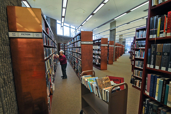 "James Neiss/staff photographerNiagara Falls, NY - Part-time library clerk Stella Leffler's motto could be the old saying ""A place for everything and everything in it's place,"" as she returns books to their proper place at the Niagara Falls Public Library."