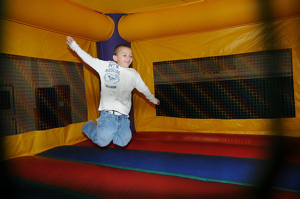James Neiss/staff photographerNiagara Falls, NY - Krystopher Stoner Jr., 6, enjoys playing in a bounce house during an open house at the Niagara Falls Branch of YMCA Buffalo-Niagara.