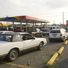 030814 Gas Station 4 - photo by vino wong/news files/power out - Automobiles wait in line to fill up gas at the Sunoco Gas Station at the corner of Military Road and Niagara Falls Boulavard. Certain areas in the city and nearby towns had power outage.