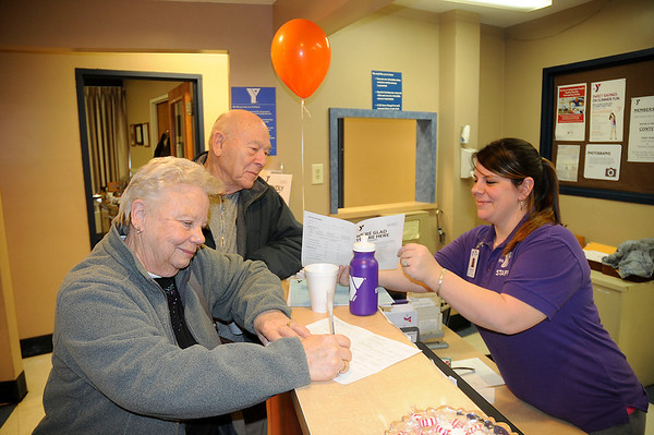 James Neiss/staff photographerNiagara Falls, NY - Evelyn and Carl Shaffer of Youngstown,  join the YMCA with the help of Membership Representative Jessica Douglas during an open house at the Niagara Falls Branch of YMCA Buffalo-Niagara.