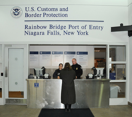 James Neiss/staff photographerNiagara Falls, NY - U.S. Customs and Border Protection officers greet a U.S. citizen at the Rainbow Bridge.