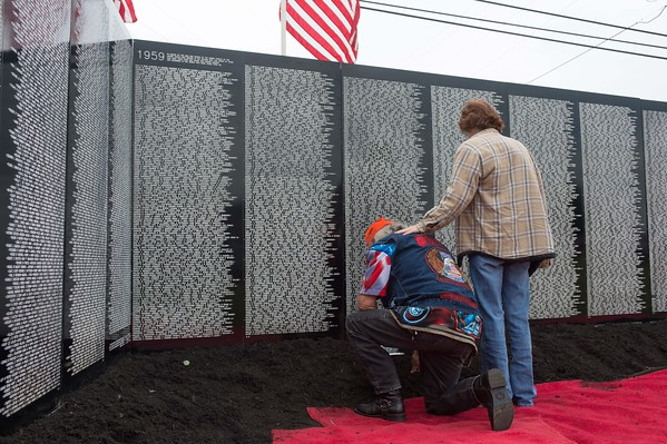 Sandy Burbank consoles an emotional Wayne Nash at the Vietnam Traveling Memorial Wall in front of Lockport Town Hall. Nash, a Vietnam Naval veteran, rode from San Diego to Lockport.