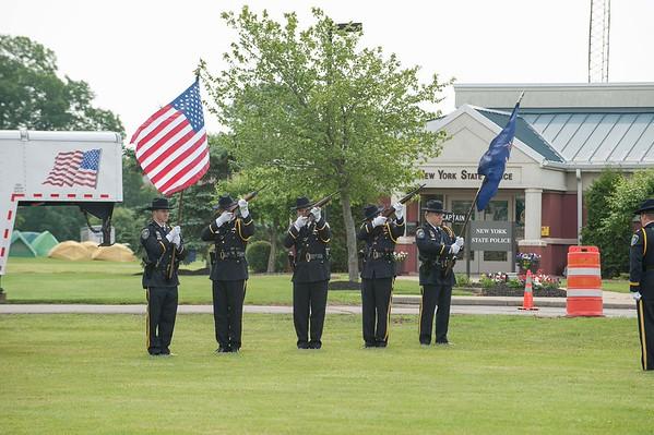 Niagara County Sheriff's deputies fire guns in salute at the Vietnam Traveling Memorial Wall.