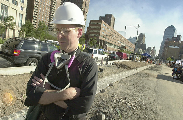 010916 WTC/day of prayer--dan cappellazzo photo--NYC Jesuit Priest Father Jim Martin SF., reflects on the devistation he saw as he stands 10 blocks from ground zero after holding a mass for rescue workers on site.