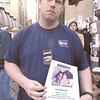010914 NYC/missing person--dan cappellazzo photo--NYC  47 precinct police officer Jerome Bonsel holds photo of his 28-yr-old missing brother Scott Timmes, who was on the 92nd floor of One WTC. Bonsel is standing in front the Lexington Armory, 26th sreet and Lexington,, Manhatten where a relief center for victims families is set up.
