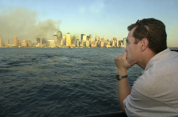 010913 NYC/NJ survivor--dan cappellazzo photo--Stand at the Jersey shore, Jersey City, NJ, Jay Henao,(201)923-9683, of Jersey City,NJ  reflects on the events of 9/11/2001 looking at the smoldering skyline of the NYC. Henao was one block away when the 1st WTC collapsed and ran for his life.
