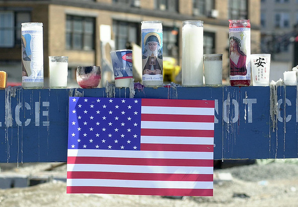 010915 WTC/Candle memorial--dan cappellazzo photo--Candles burn on a police barricade on Canal Street where rescue workers cross police lines into ground zero.