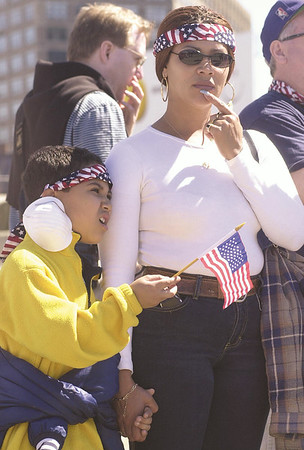 010915 WTC/waiting for heroes--dan cappellazzo photo--Santa Simo, of the Bronx holds her son Angel Santana by hand as they wait for rescue workers to return from ground zero at the corner of Canal street and West Street.