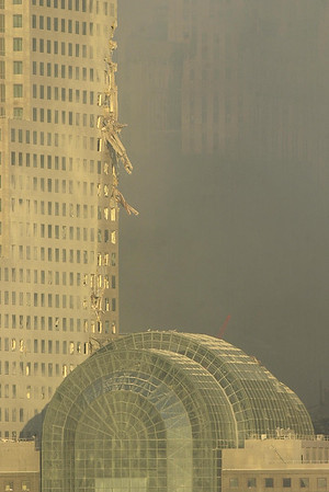 010913 NYC/WFC--dan cappellazzo photo--A close up of damage to 3 World Financial Center which is located next to where the WTC towers once stood. Officals are concerned that this is the next building to collapse. Also pictured is the Atrium bottom right, which houses the make shift mogue.