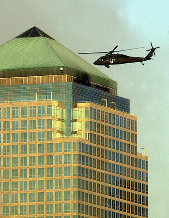 010913 NYC/helicpoter close--dan cappellazzo photo--A military helicopter takes a closer look at the top of the 3 World Financial Center. The building sits adjacent to where the WTC once stood. Officals are concerned the build  may also colapse due to damage from the WTC blasts.