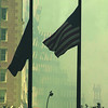 010917 WTC/flags--dan cappellazzo photo--flags fly at half mass in the Financial District in front of WTC rubble.