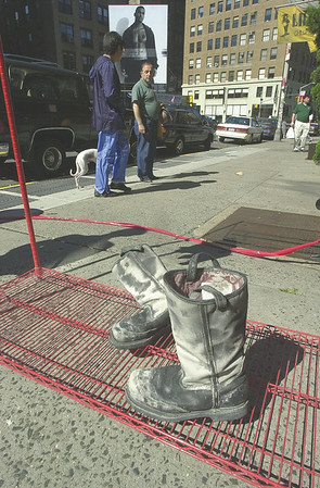010915 WTC/Firefighter boots--dan cappellazzo photo--A pair of boots from a missing firefighter sit outside of Ladder 20 Engine13 Soho Company as a tribute to firefighters who gave their lives in the WTC tragedy.