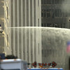 010916 WTC hosedown--dan cappellazzo photo--NYC firefighters use the water cannon to shoot water across Broadway onto the rubble of One World Trade Center.