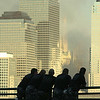 010913 police/NYC skyline--dan cappellazzo photo--members of special forces police look on at 3 World Finacial Center/The American Express Building from the New Jersey peer in Jersey City as pieces of the structure begin to fall off. Used as a make shift morgue, officals are now concern that the building is structurally unsound and may colapse.