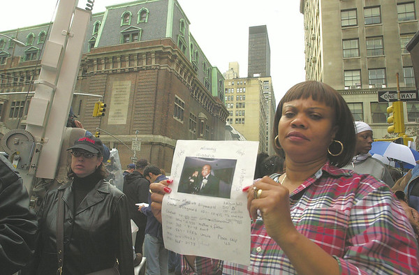 010914 NYC/Armory missing--dan cappellazzo photo--NJ resident Audrey Shaw-Simpson shows a photo and description of her nephew 21-yr-old Damion Mowatt standing in front of the Lexington Armory at Lexington Street and 26th Ave. He was on the 101st floor of One WTC at the time of the plane crash.