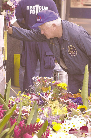 010915 WCT/Firehouse memorial--dan cappellazzo photo--Fire Dept. of New York Rescue One Ladder retired Lieutenant Paul Geidel is emotional as he reads letter of support posted at a makeshift memorial in front of the 34th street firehouse. Geidel lost one of his two sons, both firefighters at Rescue One, in the WTC tragedy. Rescue One lost almost two full companies, suffering the most severe loss of all the NYC firehouses. 350 firefighters are reported missing in the tragedy.