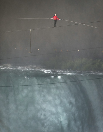 120615 Wallenda 8 Nik Wallenda walks across the Niagara Falls horseshoe Friday evening, Wallenda completed the walk in under a half hour. photo by Joed Viera