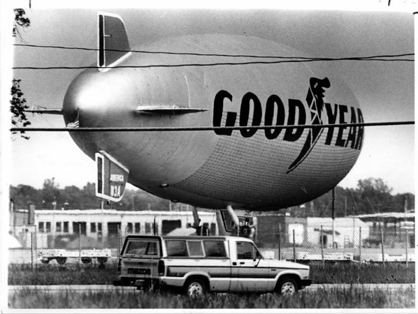 "Airplanes - Good Year Blimp<br /> The Good Year Blimp ""America"" on a stop over at the Niagara Falls International Airport. The Blimp was moored East of the Airport along Niagara Falls Blvd. at the end of WILLIAMS ROAD.<br /> Photo - By Ron Schifferle - 5/28/1985."