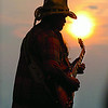 060716 guitar sunset/pp<br /> DAN CAPPELLAZZO/STAFF PHOTOGRAPHER <br /> Lewiston - Former Allman Brother guitarist Dickey Betts riffs away agianst the backdrop of the lower gorge sunset recently during the Artpark  free concert series.