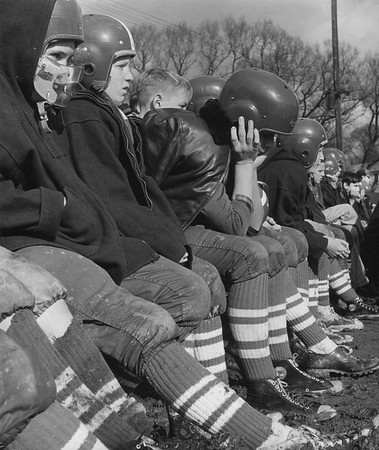 Dejection on the bench during football game, November 1956. Photo by William Tague