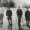 "First Williams College ski team, 1916-1917. Left to right: I.D. Townsend, A.H. Cochran, U. Roland Palmedo and E.S. Spink, Jr. The groups was called the ""ski relay team."""