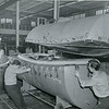 General Electric builds a one piece plastic boat.  Undated photo.