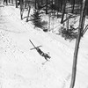 Thunderbolt Trail 1.18 mile course, Sunday, February 23, 1936, the second State Championships race.  Skier in picture is unknown, but the race was won by Jarvis Schauffer of Amherst College with a time of 2 minutes 26.4 seconds, second was his brother, Sandy. This time was 22 seconds faster than the time of Olympian Dick Durrance in 1935. Photo by Norman Ransford.