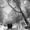 A jeep drives on Mount Greylock near the summit after an ice storm, January, 1960. Photo by William Tague.