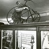 Bart Hendricks works on a bicycle in the Historical Room at the Berkshire Museum, February, 1961. Photo by William Tague.