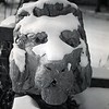Snow covered lions sculpture, undated.