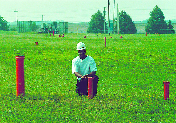 98/07/15 Love Canal Wells - James Neiss Photo - Love Canal Process Supervisor Darrell Crockett check one of many ground water monitering wells. All the chemicals are still burried underground and it's the ground water that is being tested for contamination.