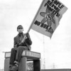 Love Canal10- protest- 14 yr old Damon Malone, with the  The Woman United For Action Group, protest atop a phone booth at the corner of 56th street and Buffalo ave. in the heart of the industrial district.,Niagara Falls. photo taken on May 13 1979
