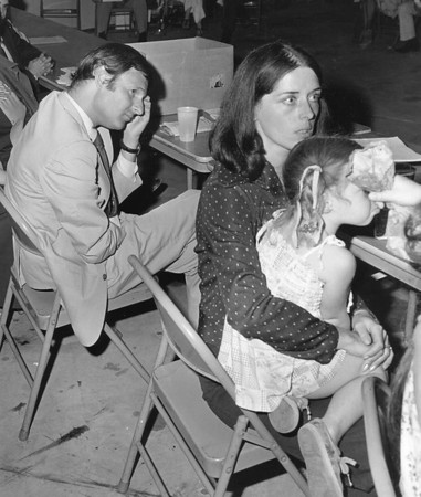 Love Canal11- gibbs- Love Canal resident/mother turn activist Lois Gibbs with her daughter at a love canal meeting  with  Gov. offical Richard Lippes in back. photo taken 1979.