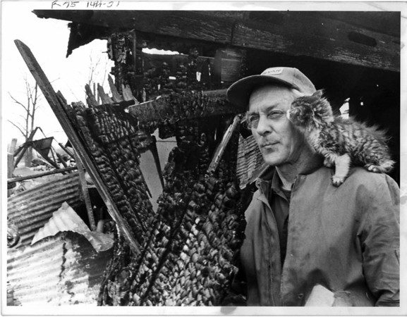 Fires - Wheatfield<br /> Frank Wrazin and his cat in Wheatfield.<br /> Photo - By Niagara Gazette - 5/4/1984.