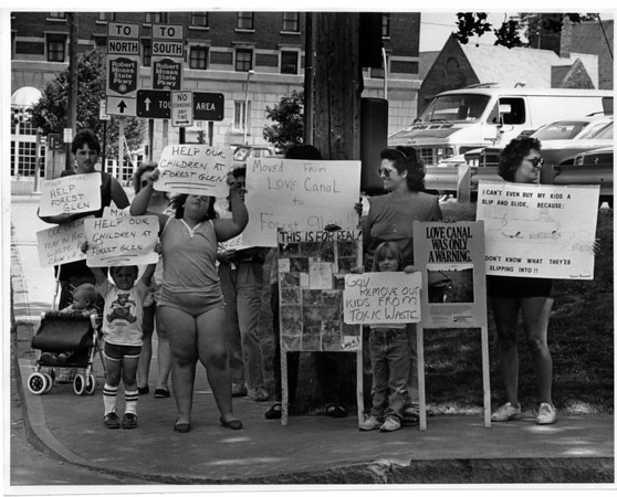 Forest Glen - Toxic Waste<br /> Informational picketing by residents of Forrest Glen at 1st and Buffalo Ave. to make there point to people leaving the press comference on Terrapin Point, Goat Island announcing the Factory Outlet Mega Mall.<br /> Photo - By Ron Schifferle - 7/18/1989.