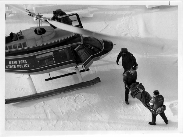 Niagara Rescue Gorge - Niagara Ambulance Personel Rick Stapleton at thead of strecher and David Miller carry a woman who fell into the gorge near the observation tower. NYS helicoptter moved her out.  Dec 22, 1989