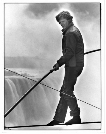 Niagara Falls, Stunters, Philippe Petit - Petit near Horseshoe Falls in Canada. Checking out wire before actual filming. Oct 5, 1986.