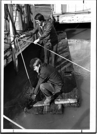 Niagara River - Rescues<br /> Geoff Smith (firegrounbd) and Ken parker - securing raft which carried 2 teenagers into Niagara River. (Smith Boys Marina, North Tonawanda).<br /> Photo - By L. C. Williams - 4/1/1980.