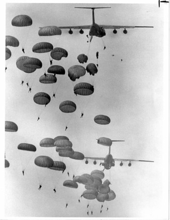Airplanes - Airshow<br /> Parachute jump over Air Base.<br /> 40th Convention of the 82nd Airborne 400 paratroopers dropping from sky over base.<br /> Photo - By James P. McCoy - 8/15/1986.