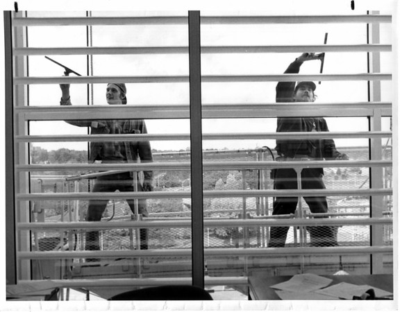 Buildings - Hooker Office Building<br /> Looking out on the 7th floor at window washers.<br /> Andrew Nowak and Gene Kelley both employed by Machelor Maintenance Service in Grand Island.<br /> Photo - By Andrew J. Susty - 10/14/1982.